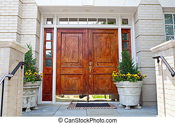 Wooden Double Door Grand Entrance to a Home - Double wood...