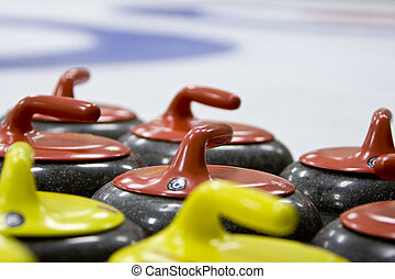 Group of Granite Curling Stones In an Ice Rink - Red and...