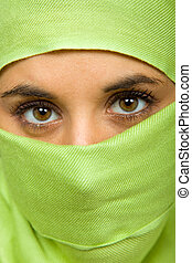 veiled - young woman with a veil close up portrait studio...