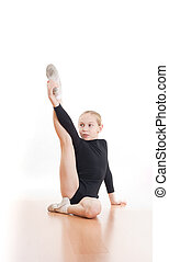 Girl making exercises on floor in bodysuit