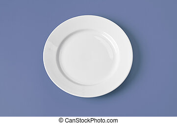 White round plate on blue background
