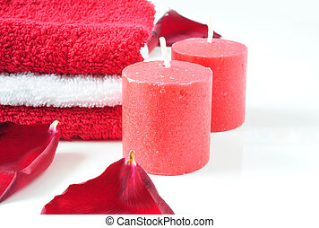 Rest in red - A tower of white and red towels, rose petals...