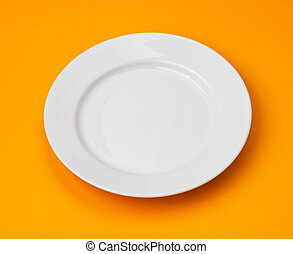 White round plate on orange background