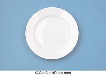 White round plate on sky blue background