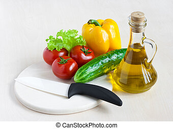 Healthy food still life with white ceramic knife