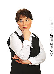 Worried mature business woman looking sideways and holding...