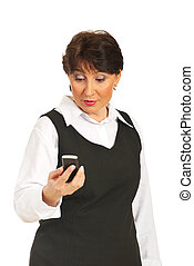 Surprised middle aged woman holding phone