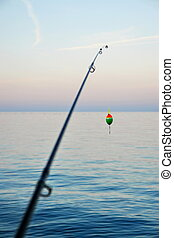 Fishing Pole - Fishing pole waiting to be cast, with line...