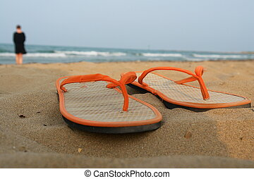 Sandals at the beach. on a hot day