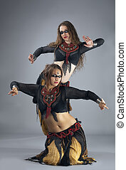 Two woman dance in warrior cosutme