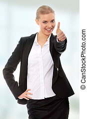 Young business woman showing OK sign, looking at camera and...