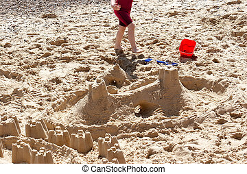 Happy feet - Building castles in the sand on a Norfolk beach
