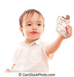 Little boy with dirty lips offers bar of chocolate in his hand