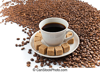 Coffee cup on heap of coffee beans