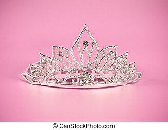 Tiara or diadem on pink background