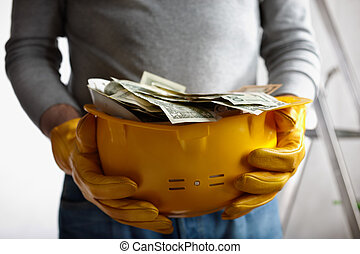 profit - financial concept with dollars and yellow hardhat,...