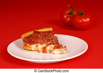 A piece of deep dish pizza with tomatoes - Piece of deep...