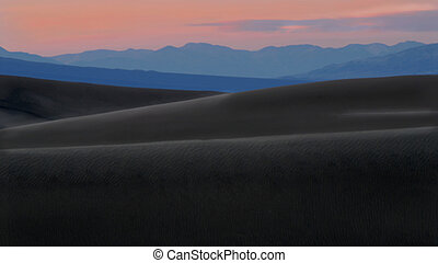 A dramatic view of the sand dunes of Death Valley California after sundown