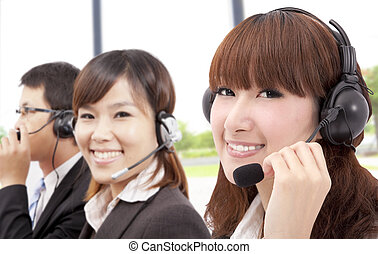 Similing business customer service team on the phone