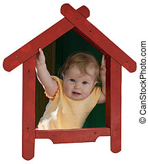 Baby-girl inside of toy house