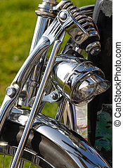 Front of a motorcycle showing chrome fender and light - The...