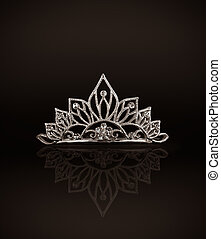 Tiara or diadem with reflection on dark background