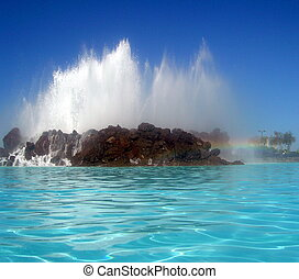 lago martianez fountain and sea water pools with rainbow in...