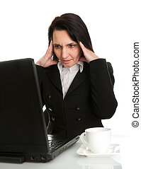 Stressful business woman working on laptop Isolated on white...