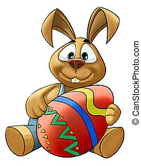 big easter egg - happy rabbit with a big colored easter egg