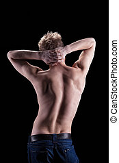 Beauty naked man spine with muscular relief