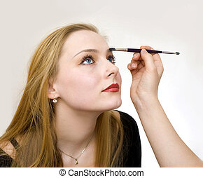 make-up - a young girl remedies a make-up
