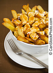 Poutine meal made with french fries, cheese curds and gravy....