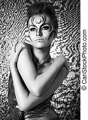 Portrait of beautiful woman with silver bodyart - bw image