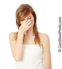 Sinus pain - Young teen woman with sinus pressure pain