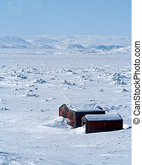 Canadian Arctic - Two Shacks in the Apex area of Iqaluit,...