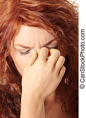 Sinus pain - Young woman with sinus pressure pain