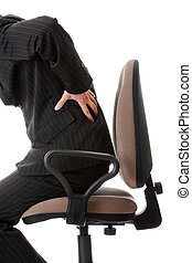 Back ache - Businessman holding his hand to his aching back
