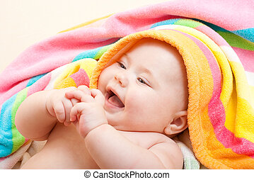 Adorable happy baby in colorful towel after bath - Adorable...