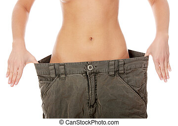Female became skinny and wearing old pants - Woman showing...