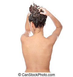 Haircare - Beautiful young brunette woman soaping her head -...