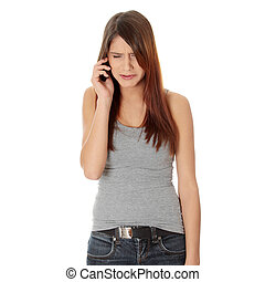 Young woman getting bad news by phone Isolated on white