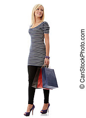 Young blond woman with shopping bags