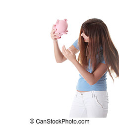 Young woman trying to get money from her piggy bank, isolated on white background