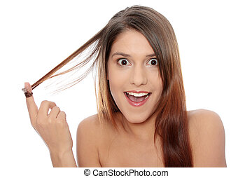 Beautiful young woman with healthy long hairs