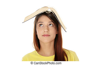 Beautiful young woman with book