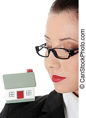Young business woman with house model - real estate