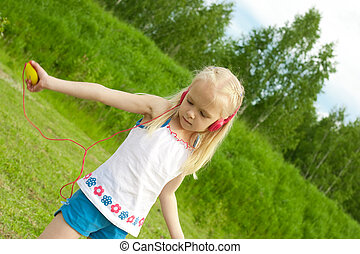Blonde girl with closed eyes red earphones is listening mp3...