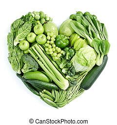 green healthy food - heart shape form by various vegetables...