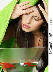 Natural medicine - Young beautiful woman making inhalation...
