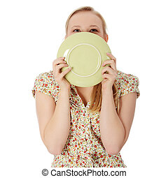 Woman licking plate - Casual blond woman licking plate